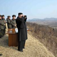 Looking at things: North Korean leader Kim Jong Un (right) inspects an artillery drill. The recent nuclear test by the country has Japan and the world on edge. | AFP-JIJI