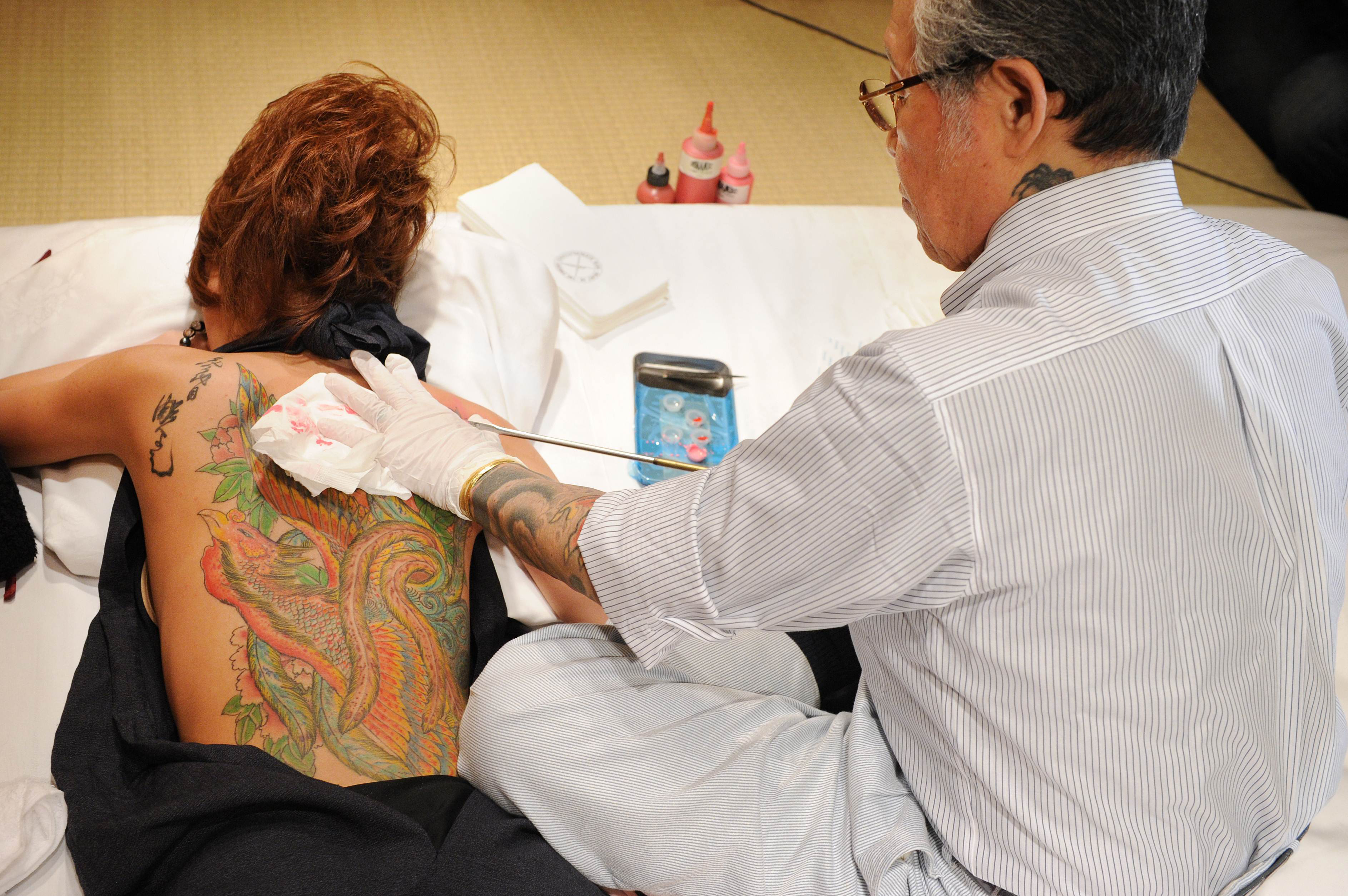 Best to consult an expert before getting a cryptic kanji tattoo master at work japanese tattooist horiyoshii iii tattoos a flower on the back of a biocorpaavc