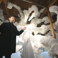 Kohei Nawa speaks in front of his artwork displayed at 'F-Art House,' a traditional Japanese-style house at Inujima. | YURIKO NAKAO