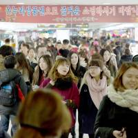 The blues: People walk through Gangnam subway station in Seoul. | BLOOMBERG