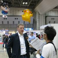 Foreign perspective: German anime buyer Daniel Otto is interviewed by members of the Japanese media on March 21 during the Tokyo International Anime Fair 2013. | KAZUAKI NAGATA .