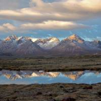 Mirror image: Vistas of majestic mountains, crystal clear lakes and broad wetlands greet visitors to the plateau of Qinghai Province. | MARC FOGGIN.