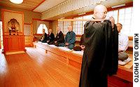 A monk (top) at the Kyoto International zen Center at Tokoji Temple in Kameoka overees trainees in their search for enlightenment, a search that gardens like Ryonaji (bottom) are meant to assist.