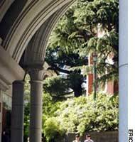 Students at Keio University in Tokyo walk through its picturesque eastern gate.