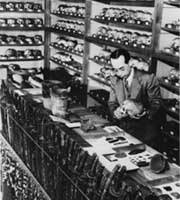 Sakuzaemon Kodama, an anatomy professor at Hokkaido University in the 1930's, with some of the Ainu skulls and artifacts he amassed.  (Photo courtesy of Hokkaido Shimbun)