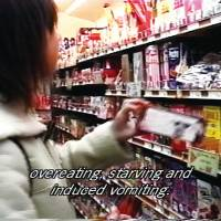 Food for thought: A scene from Yu Negoro's 2001 documentary film 'Then, She Closes Another Eye,' which delves into the relationship between eating disorders and gender issues. | © YU NEGORO
