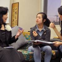 Keiko Hangui shares her story with ASIJ students Risa Endo and Ellie Nishikawa-Fu. | ELLISON STANLEY