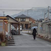 Fallout: A rainy day in Fukushima's East Sasaya temporary housing development, home to 353 evacuees. The tiny 'houses' range from 8 to 25 sq. meters in size.   WINIFRED BIRD