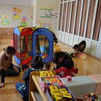 Out of the light: Mothers bring their toddlers to play, free of radiation worries, at an indoor play hour offered by Sayuri Nursery School in Fukushima. | WINIFRED BIRD