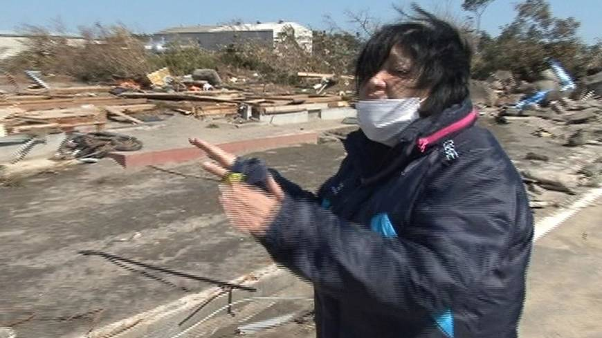 Hearing aid: Nobuko Kikuchi, a deaf resident in the city of Iwanuma, Miyagi Prefecture, shows where her house used to be before it was uprooted and washed away by the monster tsunami on March 11, 2011. | © STUDIO AYA