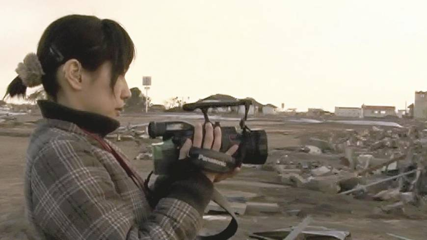 Breaking the silence: Ayako Imamura shoots footage for her latest documentary film, '3.11 Without Sound,' at Sendai Airport.