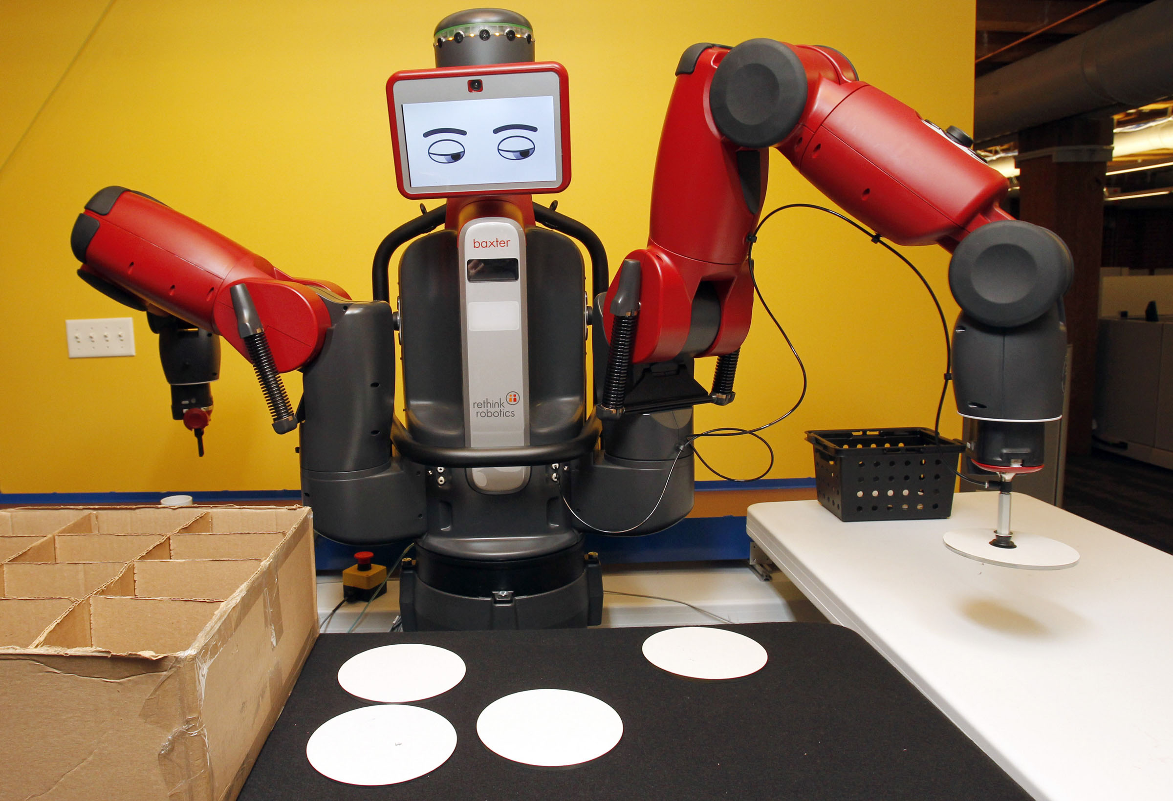 Meet your future boss: The Baxter robot was designed to work alongside real people. Its face changes expressions to warn people what it is doing.   THE WASHINGTON POST