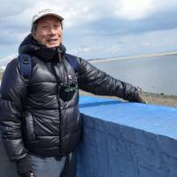 Helping hand: Ecologist Takao Suzuki studies how tidal flats recover from natural disasters. At the Sendai coast, he shows off a net that allows baby crabs to climb over one of the regions biggest environmental threats: a concrete seawall. | WINIFRED BIRD
