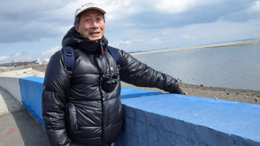 Helping hand: Ecologist Takao Suzuki studies how tidal flats recover from natural disasters. At the Sendai coast, he shows off a net that allows baby crabs to climb over one of the regions biggest environmental threats: a concrete seawall.
