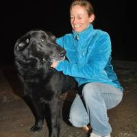 Amy Chavez weighs only slightly more than this Labrador retriever. | DEVIN SCHMIT