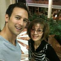 Cameo role in pop history: Satoko Condon poses for a holiday photo with son Mark in 2012. Mark told the story of his mother's experience serving the Beatles on their 1966 flight from London to Tokyo in a recent blog post. | COURTESY OF MARK CONDON