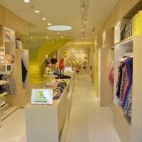 Bright sights: The interior and exterior of Kate Spade Saturday's first flagship store in Omotesando, Tokyo, are in an unmissable canary yellow. | COURTESY OF KATE SPADE SATURDAY