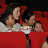 Lights-out time: Taking the baby to the cinema is a rare luxury well received. | TOHO