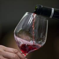 Night caps: A glass of wine per night has been shown to significantly cut the risk of Alzheimer's disease. | BLOOMBERG