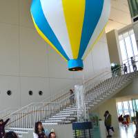 Fresh air vs. hot air: The Gas Science Museum from the outside (above) and the hot air balloon within (right). | JASON JENKINS