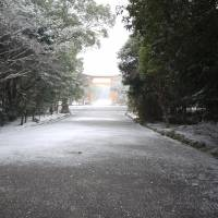 Best of luck: Usa Shrine, reached by long entrance paths that look especially pretty in a sudden snowstorm, is a 'power spot' destination for those wishing for favorable fortune.  FAR RIGHT: VISITORS TO THE SHRINE WRITE THEIR WISHES ON WOODEN  EMA | PLAQUES.