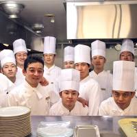 All part of the service: Thierry Voisin (far left), Chef de Cuisine at The Imperial Hotel's Les Saisons restaurant, with his kitchen crew. | KIT NAGAMURA