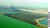 A land bridge that will connect the existing runway at Kansai International Airport and a new runway to be completed by 2007 is featured in this photograph.