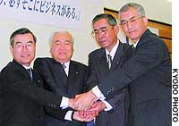 NTT West Corp. President Kazuo Asada (seocnd from lef) gets together for a news conference  in Osaka with the chiefs of three of the firm's 49 new subsidiaries.