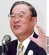 Toyota Motor Corp. President Fujio Cho announces his company's record consolidated profits at the Nagoya Stock Exhange.