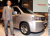 Hiroyuki Yoshino, president of Honda Motor Co., launches the automaker's new Mobilio Spike during a media preview in Tokyo.