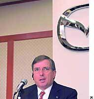 Lewis Booth, president of Mazda Motor Corp., announces on Monday plans to shut down a truck plant in Fuchu, Hiroshima Prefecture.