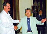 Mexican President Vicente Fox greets Prime Minister Junichiro Koizumi on Sunday night at a hotel in Los Cabos, Mexico.