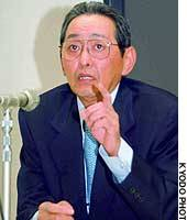 Kunio Nakamura, president of Matsushita Electric Industrial Co., announces his company's interim earnings in Tokyo.