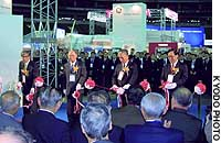 Kyushu Electric Power Co. President Michisada Kamata (second from left) and other guests open an exhibition on the sidelines of an electricity suppliers' conference at Fukuoka Dome.