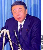 Farm Minister Sadamori Oshima speaks to reporters at the Agriculture, Forestry and Fisheries Ministry.