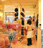 A customer checks out lingerie at Amo's Style, operated by Triumph International, in Tokyo's Harajuku district.