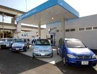Fuel-cell cars line up at a hydrogen station in Yokohama as part of the nation's first extensive test run of the vehicles.