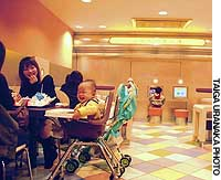 A family has a meal in the children's area of the McDonald's Oji outlet in Kita Ward, Tokyo.