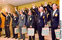 Employees of Seibu Department Stores Ltd. take part in a pep rally at the firm's flagship store in Ikebukuro, Tokyo, to kick off its summer gift campaign.