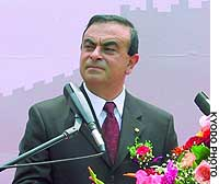 Nissan Motor Co. President Carlos Ghosn delivers a speech at the inaugural ceremony for a joint car-manufacturing venture with China's DongFeng Motor Corp. in Wuhan, Hubei Province.