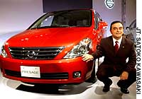 Carlos Ghosn, chief executive officer of Nissan Motor Co., showcases the new Presage minivan in Tokyo.