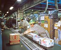Employees route parcels at a Yamato Transport delivery center in Itabashi, Tokyo.   PHOTO COURTESY OF YAMATO TRANSPORT CO.