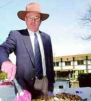 CANBERRA -- A cattle farmer stages an Aussie-style barbecue Friday outside the Japanese Embassy to protest Tokyo's move to raise tariffs on Aussie beef imports (AP Photo)