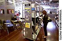 Shoppers at Tsutaya's Roppongi outlet read books on the store's first floor, which shares space with a Starbucks Coffee shop.