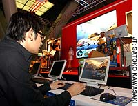 An aficionado plays at the Online Game Fantasista, held last month in Tokyo by Softbank group. The one-day event showcased online games by 12 Japanese and 40 South Korean companies.