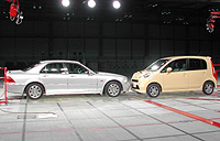 A Honda Life minicar and Legend luxury sedan are placed face to face before a crash test at Honda's research and development center in Haga, Tochigi Prefecture. | AKEMI NAKAMURA PHOTO