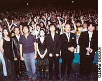 The cast and crew of ``Bayside Shakedown 2'' get a rousing welcome from spectators at the film's debut in Tokyo. | PHOTO COURTESY OF TOHO CO.