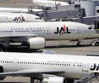 Pension in full stall?: Japan Airlines planes sit at Tokyo's Haneda airport in April. | BLOOMBERG
