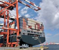Waiting for cargo: The Nippon Yusen K.K. container ship NYK Athena is docked at a terminal in Tokyo Bay in November 2005. | BLOOMBERG PHOTO