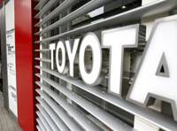 Not driving away: A woman leaves a showroom of recall-plagued Toyota Motor Corp. in Tokyo on Thursday.   AP PHOTO